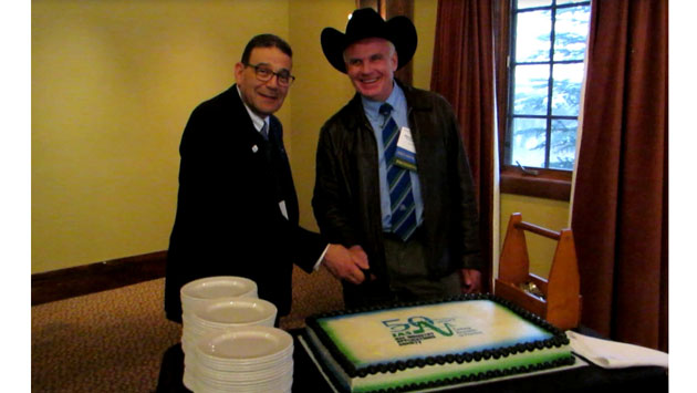 Rasheek Rifaat, Chair of the IAS I&CPS Technical Department and IAS President, David Duroucher cut the IAS 50th Anniversary birthday cake at I&CPS in Calgary, Alberta, Canada